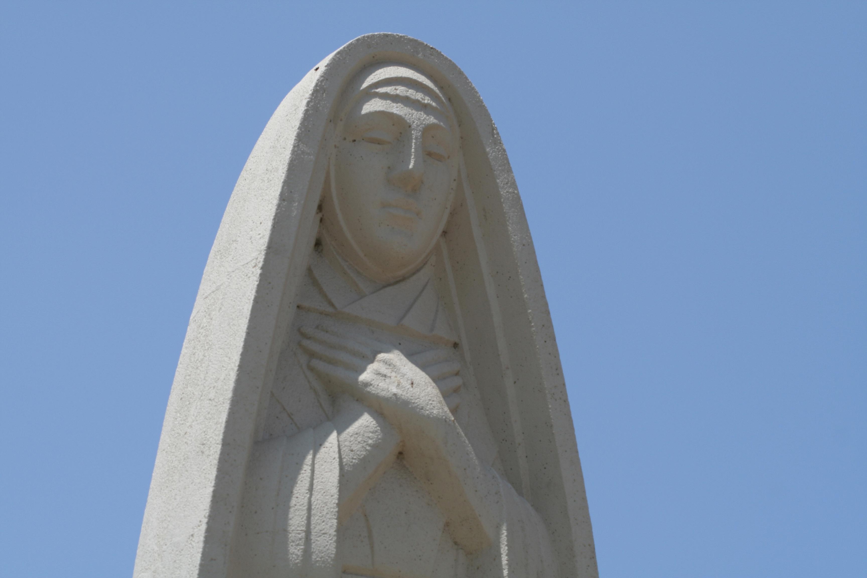 The art deco statue of Saint Monica  still stands in the city's public park